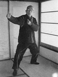 Takamatsu holding a Migi no Kamae with Boshi Ken