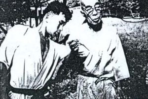 Takamatsu Sensei demonstrating Musha dori on Hatsumi Sensei; part of the Kihon Happo
