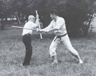Takamatsu_Ninjutsu: Takamatsu teaching Hatsumi Bo staff techniques against sword.