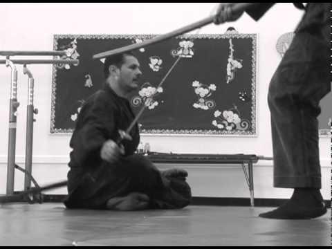 Dr. Kacem Zoughari demonstrating a Shinden Fudo Ryu Iai technique from half lotus